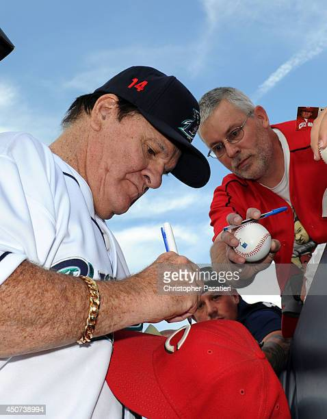 Former Major League Baseball player Pete Rose signs an autograph prior to managing the game for the Bridgeport Bluefish against the Lancaster...