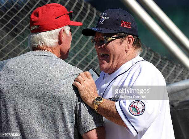 Former Major League Baseball player Pete Rose talks with manager Butch Hobson of the Lancaster Barnstormers during batting practice prior to managing...