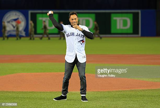 Former Major League Baseball player Roberto Alomar throws out the ceremonial first pitch prior to the American League Wild Card game between the...