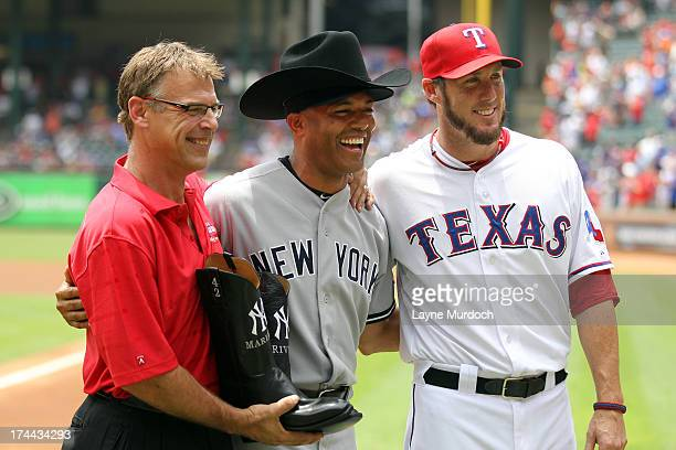 Former Major League pitcher John Wetteland and Joe Nathan closing pitcher for the Texas Rangers present Mariano Rivera of the New York Yankees a pair...