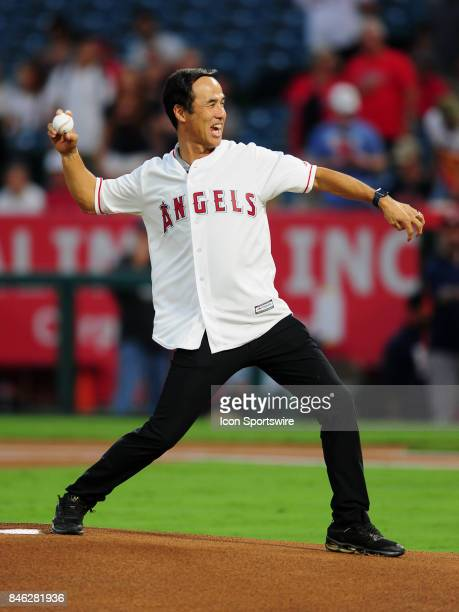 Former major league pitcher Shigatoshi Hasegawa throws out the first pitch before a game between the Houston Astros and the Los Angeles Angels of...