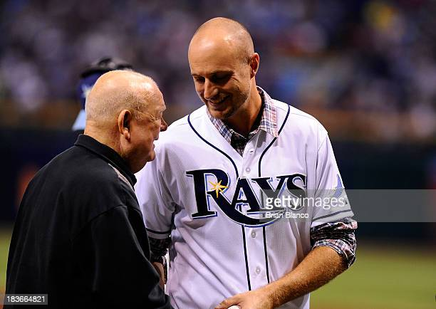 Former major league player Rocco Baldelli speaks with Don Zimmer after throwing out the ceremonial first pitch before Game Four of the American...