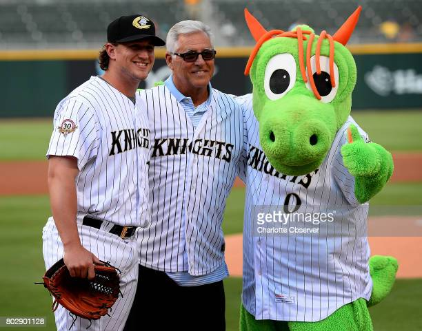 Former major league shortstop Bucky Dent center poses with Charlotte Knights pitcher Carson Fulmer left and mascot Homer after throwing the...