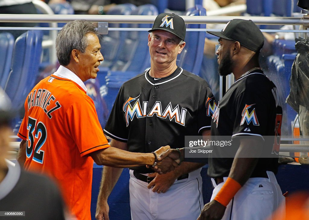 Former major leaguer Dennis Martinez (L) shakes hands with Marcell Ozuna #13 of the Miami Marlins as manager Dan Jennings looks on from center before the Marlins faced the Atlanta Braves at Marlins Park on September 27, 2015 in Miami, Florida.