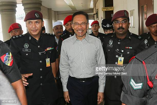 Former Malaysian opposition leader Anwar Ibrahim arrives at court for the defamation suit hearing against his former tennis partner S Nallakaruppan...