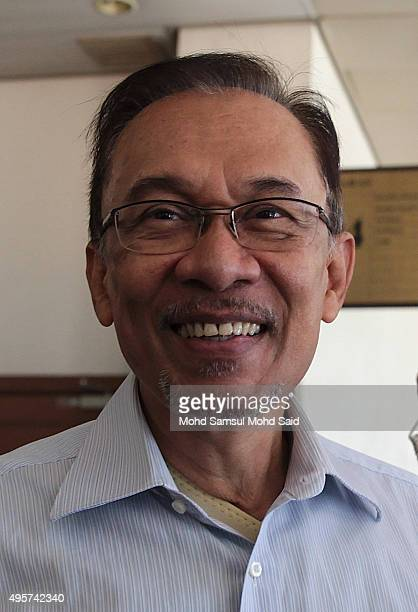 Former Malaysian opposition leader Anwar Ibrahim smile as he arrive at courthouse on November 5 2015 in Kuala Lumpur Malaysia Anwar Ibrahim received...