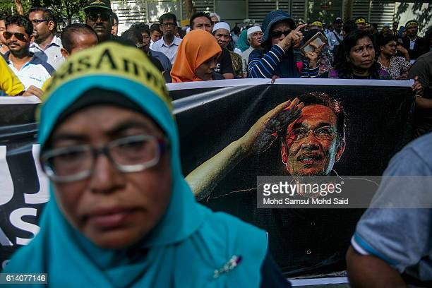 Former Malaysian opposition leader Anwar Ibrahim supporters gathering outside the courthouse during Anwar Ibrahim hearing in sodomy case on October...
