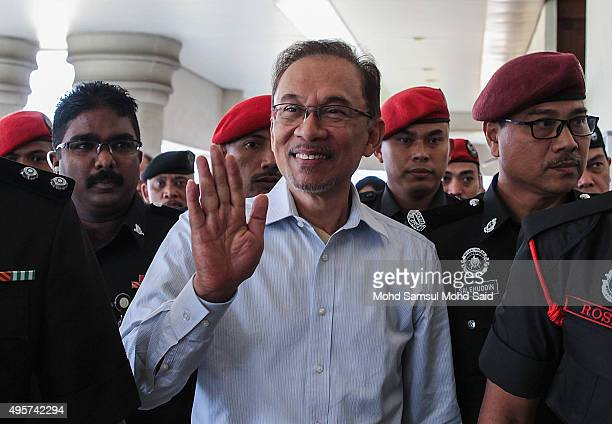 Former Malaysian opposition leader Anwar Ibrahim wave to his supporters at courthouse on November 5 2015 in Kuala Lumpur Malaysia Anwar Ibrahim...