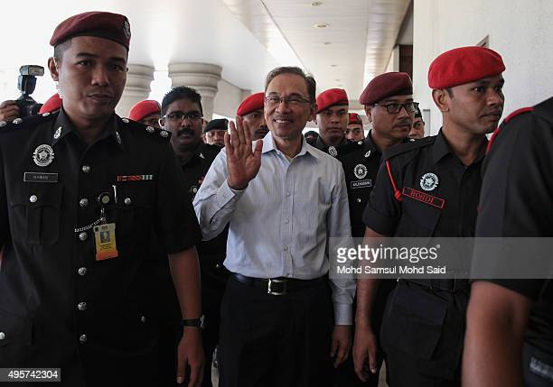 Former Malaysian opposition leader Anwar Ibrahim waves to his supporters at courthouse on November 5 2015 in Kuala Lumpur Malaysia Anwar Ibrahim...
