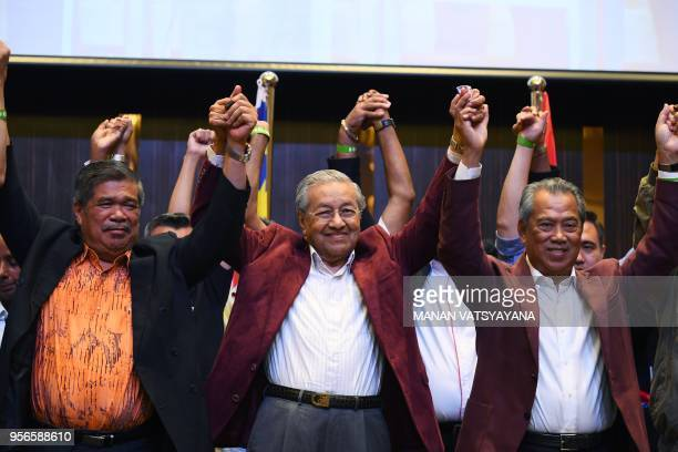 Former Malaysian prime minister and opposition candidate Mahathir Mohamad celebrates with other leaders of his coalition during a press conference...
