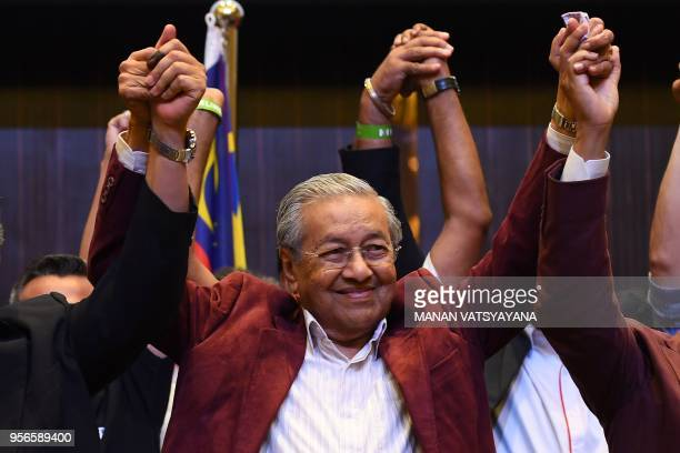 Former Malaysian prime minister and opposition candidate Mahathir Mohamad celebrates with other leaders of his coalition during a press conference in...