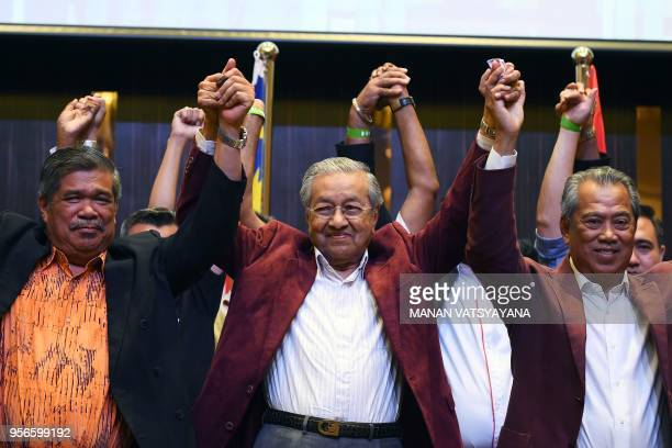 Former Malaysian prime minister and opposition candidate Mahathir Mohamad celebrates with his coalition leaders during a press conference in Kuala...
