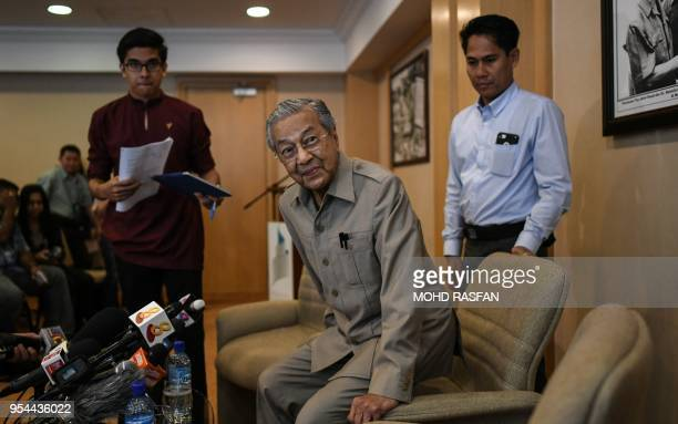 Former Malaysian prime minister and opposition party Pakatan Harapan's prime ministerial candidate Mahathir Mohamad arrives for a press conference...