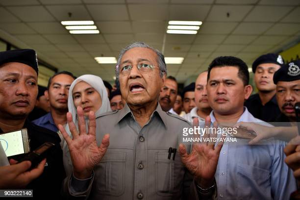 Former Malaysian prime minister and opposition's prime ministerial candidate Mahathir Mohamad gestures while addressing mediapersons after being...