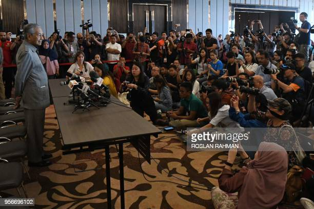 Former Malaysian prime minister and winning opposition candidate Mahathir Mohamad speaks to journalists during a press conference in Kuala Lumpur on...