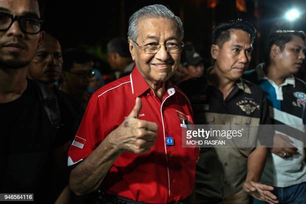 Former Malaysian Prime Minister Mahathir Mohamad gestures as he arrives for a rally ahead of the 14th general election on Malaysia's island of...