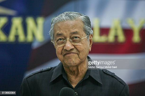 """Former Malaysian prime minister Mahathir Mohamad speaks to journalist during the news conference """"Save Malaysia"""" signing of the declaration demanding..."""