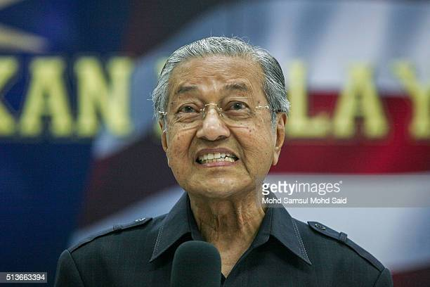 Former Malaysian prime minister Mahathir Mohamad speaks to journalist during the news conference Save Malaysia signing of the declaration demanding...