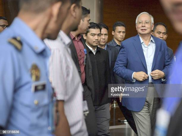 Former Malaysian Prime Minister Najib Abdul Razak leaves after interrogation at the AntiCorruption Commission in Putrajaya the federal administrative...