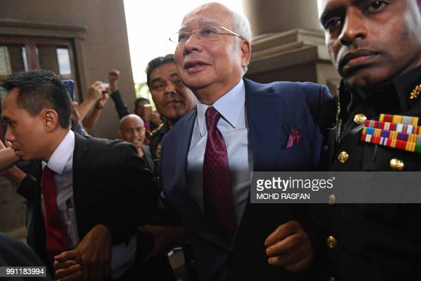 Former Malaysian prime minister Najib Razak arrives for a court appearance at the Duta court complex in Kuala Lumpur on July 4 2018 Najib was...