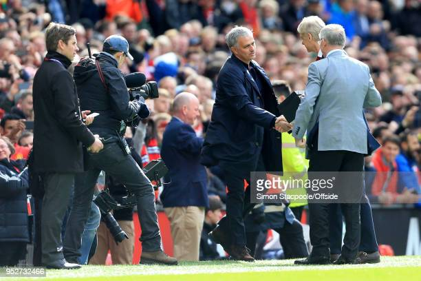 Former Man Utd manager Sir Alex Ferguson and current Man Utd manager Jose Mourinho greet Arsenal manager Arsene Wenger and present him with a gift...