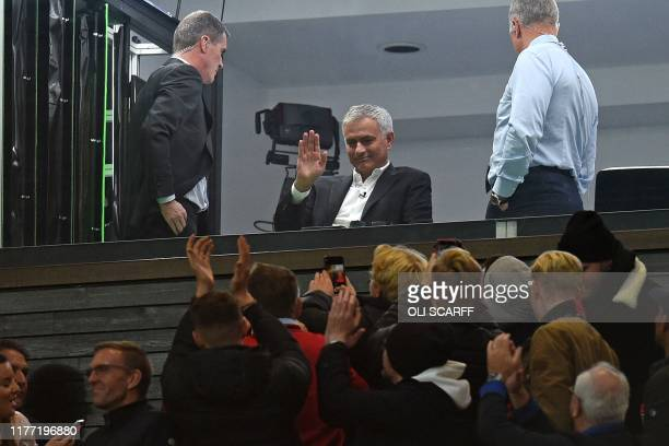TOPSHOT Former manager Jose Mourinho waves to fans from the TV studio during the English Premier League football match between Manchester United and...