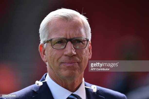 Former manager of Crystal Palace and Newcastle Alan Pardew arrives to work for the media ahead of the English Premier League football match between...