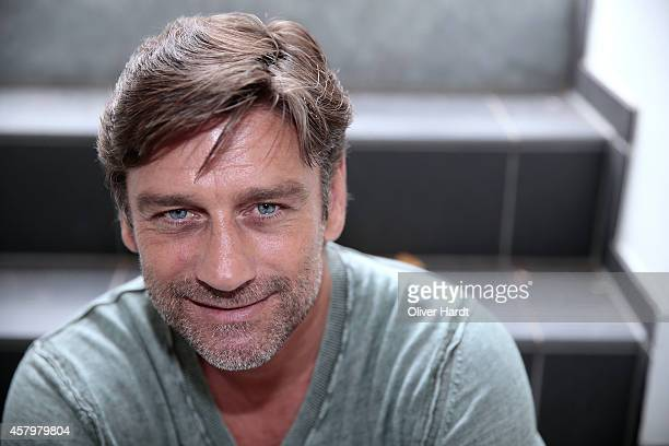 Former Manager of Hamburger SV Oliver Kreuzer poses for a photocall during an interview for Kicker Sportmagazin on August 7 2014 in Hamburg Germany