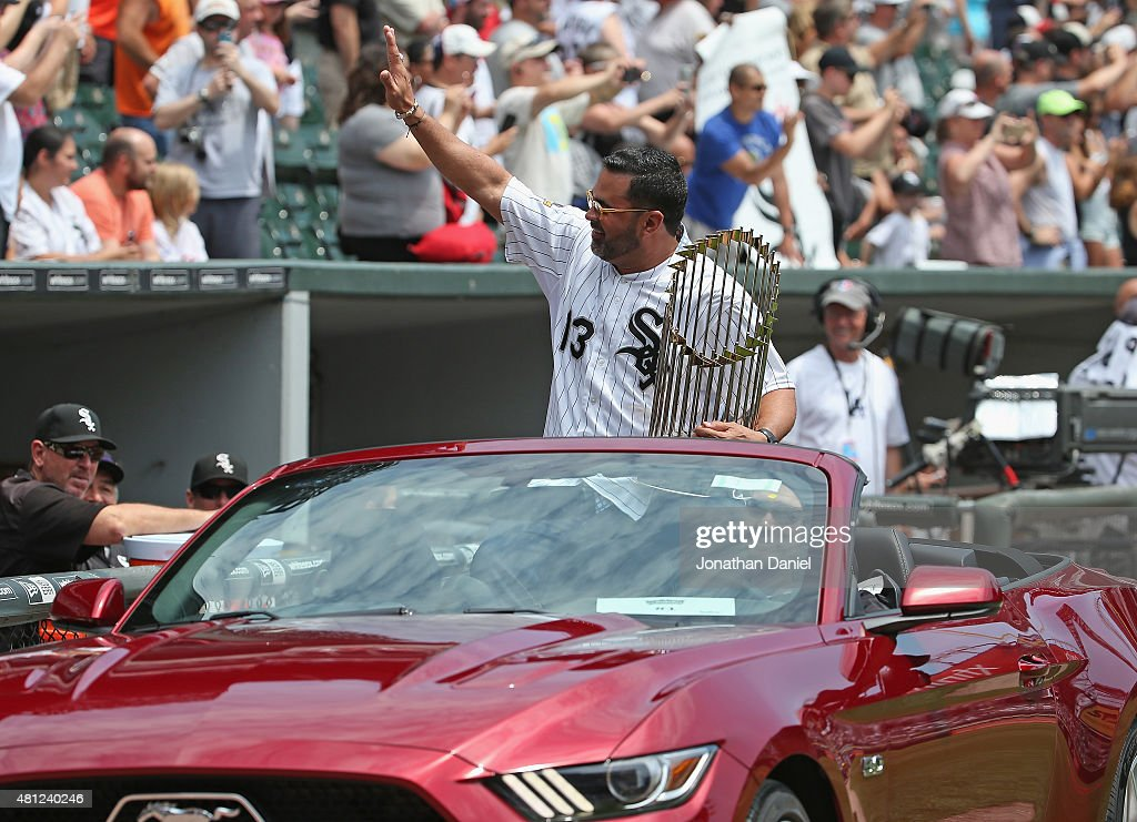 Former manager Ozzie Gullien of the Chicago White Sox greets the crowd as he rides in with the World Series trophy for a ceremony honoring the 10th anniversary of the 2005 World Series Champion Chicago White Sox team before a game against the Kansas City Royals at U.S. Cellular Field on July 18, 2015 in Chicago, Illinois.