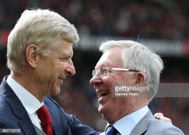 Former Manager Sir Alex Ferguson of Manchester United greets Manager Arsene Wenger of Arsenal ahead of the Premier League match between Manchester...