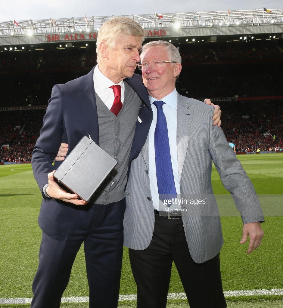 Former manager Sir Alex Ferguson of Manchester United presents Manager Arsene Wenger of Arsenal with a gift to mark his retirement ahead of the Premier League match between Manchester United and Arsenal at Old Trafford on April 29, 2018 in Manchester, England.