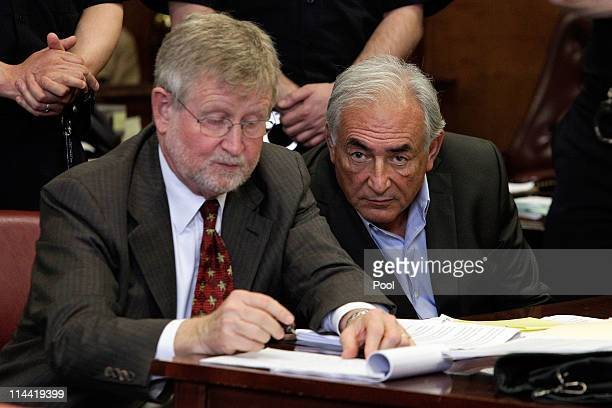 Former Managing Director of the International Monetary Fund Dominique StraussKahn and his lawyer William Taylor appear in State Supreme Court for a...