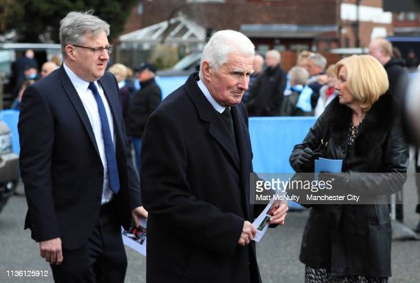 Former Manchester City player Tony Buck leaves the service at the Funeral of Manchester City Life President Bernard Halford at St Mary's Church in...