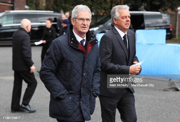 Former Manchester City Youth Academy Director Jimmy Cassell leaves the service with Manchester City Academy kit man Rod Owen at the Funeral of...