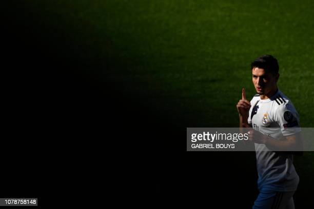 TOPSHOT Former Manchester City's Spanish midfielder Brahim Diaz gestures during his official presentation as Real Madrid's player at the Santiago...