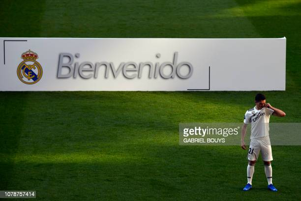 Former Manchester City's Spanish midfielder Brahim Diaz kisses his new jersey's badge during his official presentation as Real Madrid's player at the...