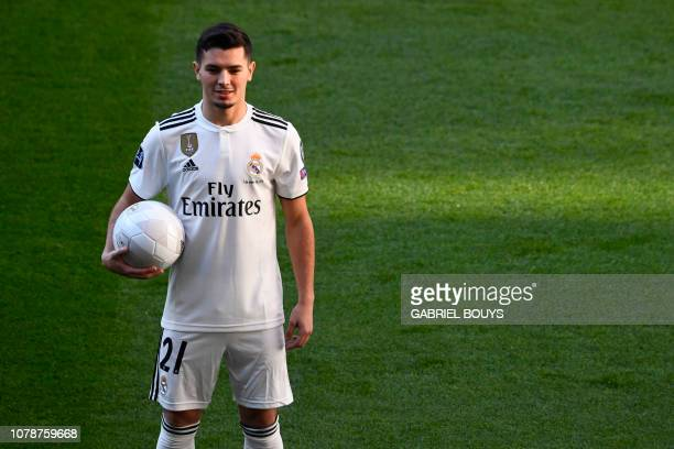 TOPSHOT Former Manchester City's Spanish midfielder Brahim Diaz poses during his official presentation as Real Madrid's player at the Santiago...