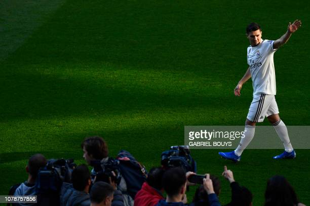 Former Manchester City's Spanish midfielder Brahim Diaz waves during his official presentation as Real Madrid's player at the Santiago Bernabeu...