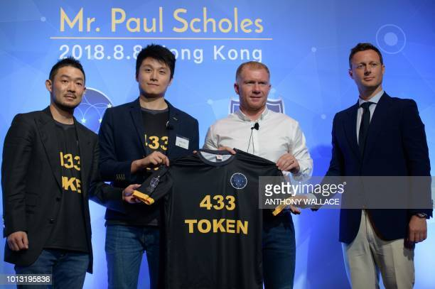 Former Manchester United and England football player Paul Scholes is presented with a 433 Token jersey as he stands with Soccer Legends Ltd cofounder...