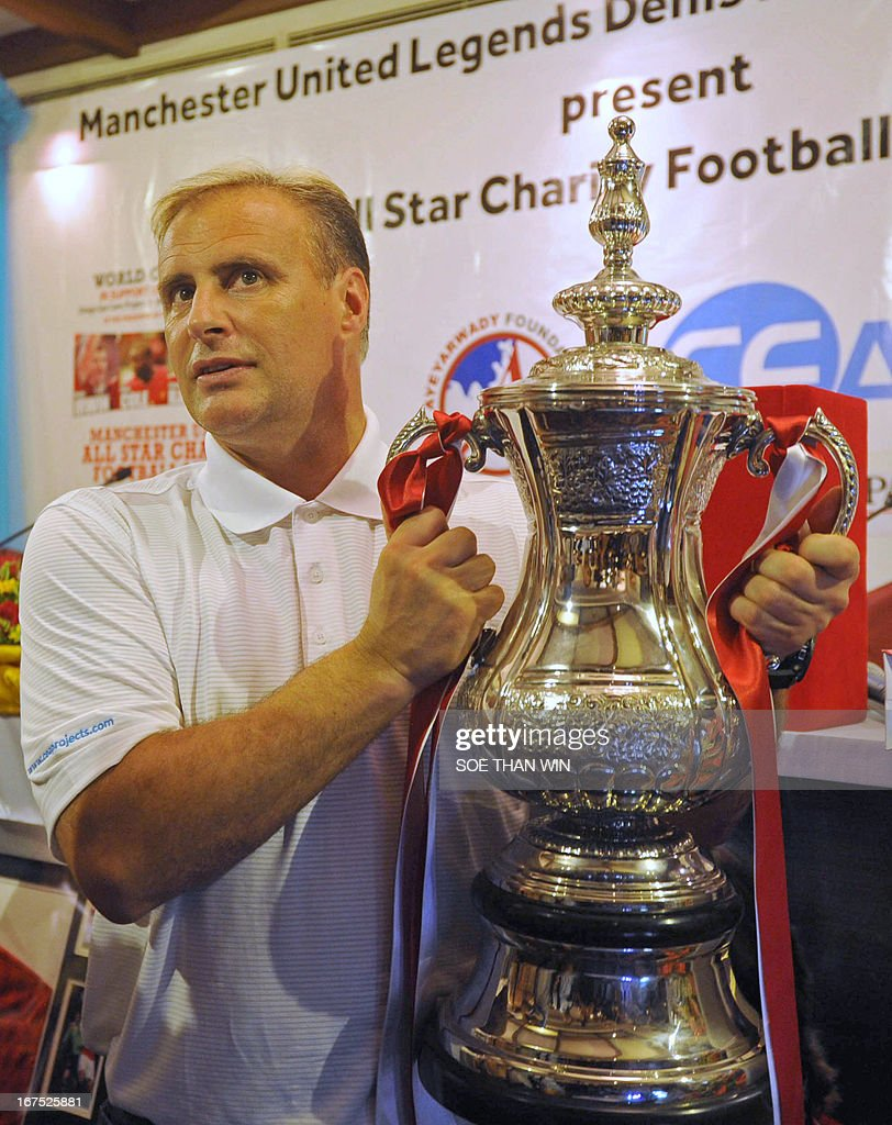 Former Manchester United football player Clayton Blackmore poses for a photo during a press conference in Yangon on April 26, 2013. Former Manchester United players Denis Irwin, Andy Cole, Clayton Blackmore and Lee Sharpe will play in a charity football match in Yangon on June 9. AFP PHOTO / Soe Than WIN