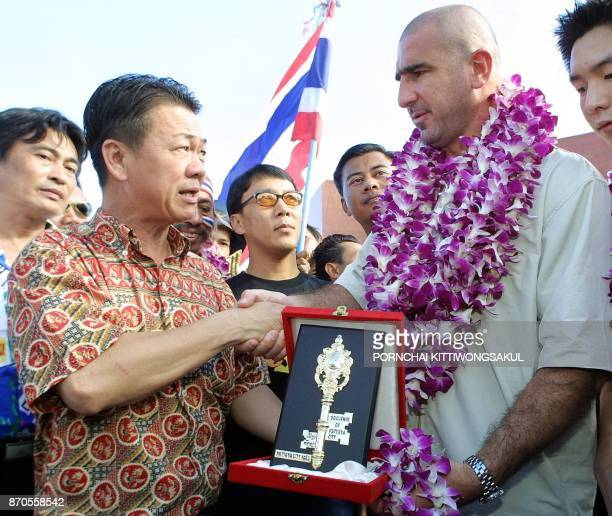 Former Manchester United football player Eric Cantona receive the key to the city of Pattaya from The Pattaya Governor Pairat Suthithamrongsawat...