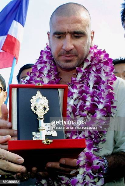 Former Manchester United football player Eric Cantona recieves the key to the city of Pattaya from The Pattaya Governor Pairat Suthithamrongsawat...