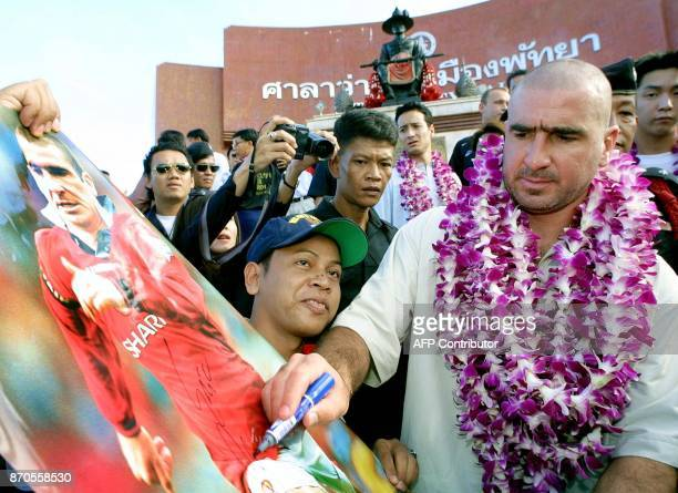 Former Manchester United football player Eric Cantona signs his autograph for his fan club during a welcoming ceremony at Pattaya in Chonburi...