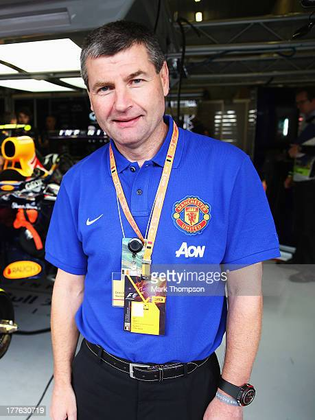 Former Manchester United footballer Dennis Irwin is seen in the Infiniti Red Bull Racing garage before the Belgian Grand Prix at Circuit de...