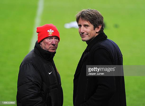 Former Manchester United goalkeeper Edwin van der Sar chats with Sir Alex Ferguson manager of Manchester United during a training session on the eve...