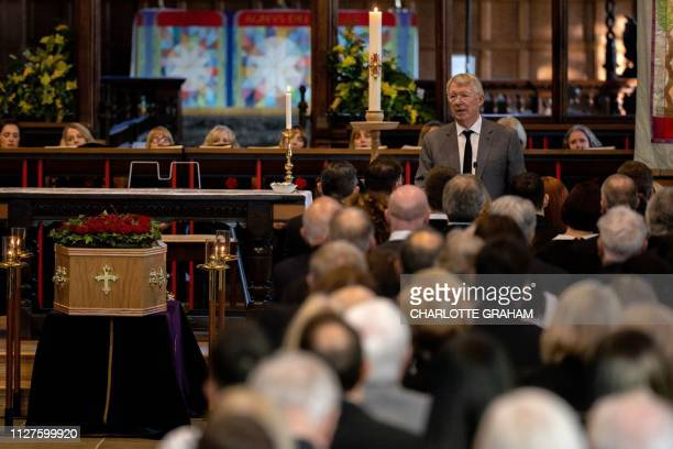 Former Manchester United manager Alex Ferguson gives the Eulogy as footballers and celebrities attend the funeral of Eric Harrison at Halifax Minster...