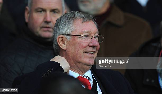 Former Manchester United manager Alex Ferguson looks on before the Barclays Premier League match between Cardiff City and Manchester United at...