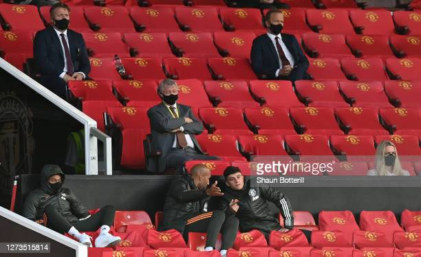 Former Manchester United manager Sir Alex Ferguson looks on from behind the bench as Jesse Lingard and Daniel James of Manchester United are seen...