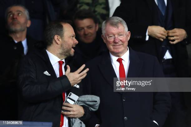 Former Manchester United Manager, Sir Alex Ferguson stands next to Manchester United owner, Ed Woodward during the UEFA Champions League Round of 16...