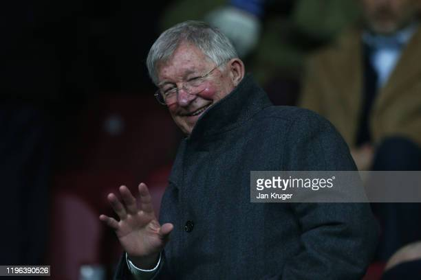 Former Manchester United Manager Sir Alex Ferguson waves before the Premier League match between Burnley FC and Manchester United at Turf Moor on...